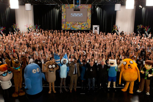 "(Front line, left to right)-Beloved cartoon characters over the last 20 years surround Atlanta Mayor Kasim Reed, Councilmember Keisha Lance Bottoms, Cartoon Network President and COO Stuart Snyder and Turner Broadcasting Chairman and CEO Phil Kent at Cartoon Network's 20th Birthday party.  Reed and Bottoms proclaimed ""Cartoon Network Day"" in Atlanta, and joined hundreds of employees for the special event which included a giant custom cake and entertainment from the Atlanta Falcons Drumline.  (PRNewsFoto/Cartoon Network)"