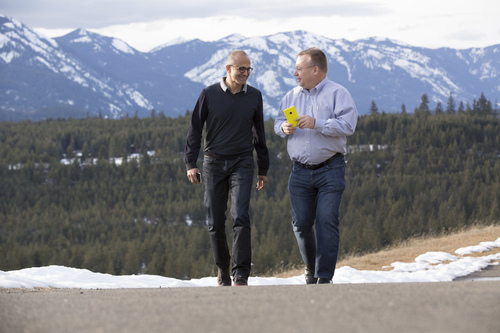 Microsoft CEO Satya Nadella (left) and executive vice president of Microsoft Devices Group Stephen Elop share a  ...