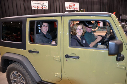 Sweepstakes winner Cheryl Powers and husband Shawn Powers (back seat) checked out a Jeep(R) Wrangler Unlimited ...