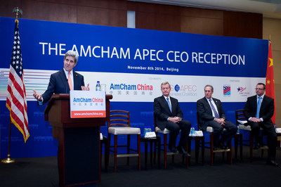 US Secretary of State John Kerry addresses The AmCham APEC CEO Reception in Beijing, watched by US Ambassador to China Max Baucus, US Trade Representative Michael Froman, and American Chamber of Commerce in China President Mark Duval. Photo: AmCham China