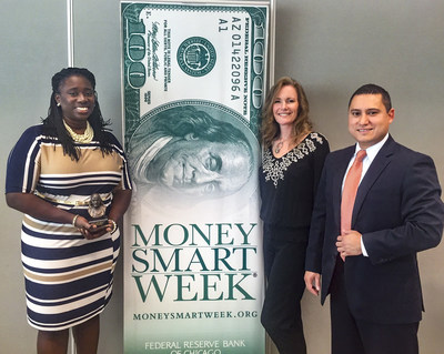 Sherri Webb (left) of Ally receives recognition from Kelly Masters, chair of Money Smart Week(R) Michigan and Alejo Torres, senior outreach program manager with the Federal Reserve Bank of Chicago for Ally's participation in Money Smart Week.