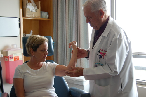 Lori Madsen, a San Francisco area school teacher, recently scraped her arm and developed necrotizing fasciitis.  Dr. John Crew of Seton Medical Center in Daly City, California successfully treated Lori's arm with a combination of NeutroPhase, a wound cleanser, and surgery. (PRNewsFoto/Dr. John Crew)
