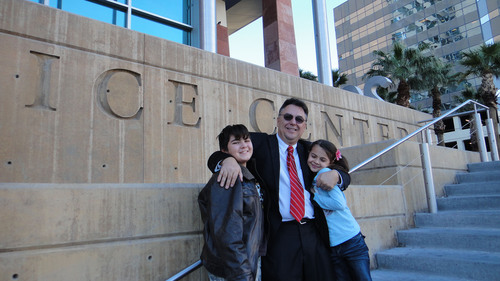 Tony Dane (Center) gives his children a hug after winning breach of contract suit against GEICO Insurance Co. ...