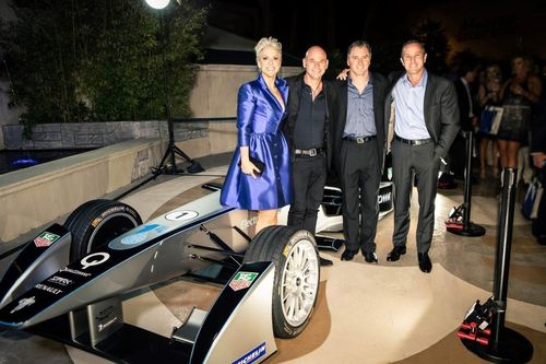 Catherine Banchard, CEO of ONE DROP, Guy Laliberte, Founder of Cirque du Soleil, and Formula E representatives Chris Schroeder and Robert Lavia beside the Formula E car during the announcement of the new Formula E and ONE DROP partnership. (PRNewsFoto/ONE DROP)