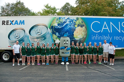 Pictured at the Rexam Cans for Cash event is the St. Patrick's cheerleading squad with the Rexam Can Man and Rexam reps in white shirts (from left) Claude Marbach, vice president, Sales and Marketing; Greg Brooke, vice president, Corporate Affairs; and Nancy Mose, Sr. Supply Chain Analyst.  (PRNewsFoto/Rexam)