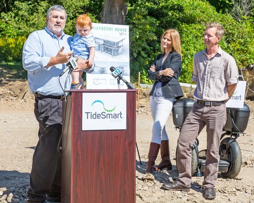 At the groundbreaking ceremony for the Viridescent House, Steve Woods, TideSmart CEO, held his grandson, Jax while he spoke about the need to invest in energy efficient building today in order to help future generations. While his wife, Katie Woods and Founding Partner & Principal Architect at BRIBURN, Chris Briley listened. (PRNewsFoto/TideSmart Global)