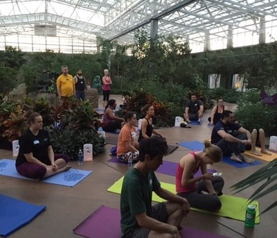 Wounded veterans and their guests practice yoga at an indoor rainforest in Arizona.