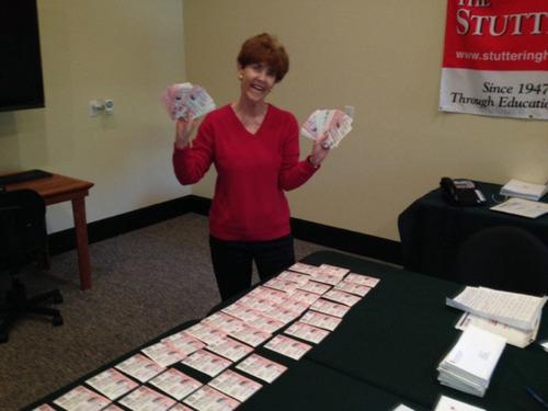 Stuttering Foundation President Jane Fraser with the Mega Million tickets Friday. (PRNewsFoto/The Stuttering Foundation) (PRNewsFoto/THE STUTTERING FOUNDATION)
