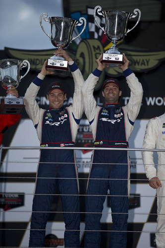 Drivers Kuno Wittmer, left, and Jonathan Bomarito hoist the winner trophies and celebrate after piloting the No. 93 Dodge Viper SRT GTS-R race car to a first-place finish in the GTLM class in the IMSA TUDOR United SportsCar Championship Brickyard Grand Prix on Friday, July 25, 2014. (PRNewsFoto/Chrysler Group LLC)