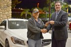 Soboba Casino's Director of Marketing Michael J. Broderick proudly hands the keys of a brand new Mercedes to Vietnam veteran Francis Abergas.