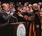 """Cheryl Boone Isaacs, center, received an honorary doctorate of the arts from Robert L. """"Rob"""" King III, chairman of the Board of Trustees, and Lindsay Bierman, Chancellor of the University of North Carolina School of the Arts."""