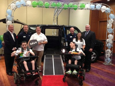 Kyle and Paula Watson, whose twin 14-year old boys - Scott and Ian, have cerebral palsy and use large motorized wheelchairs, won the Mobility Ventures MV-1 universally accessible vehicle through the annual National Mobility Awareness Month (NMAM) online contest that includes sharing their personal story with NMAM site viewers who voted to select the finalists. (PRNewsFoto/Mobility Ventures LLC)
