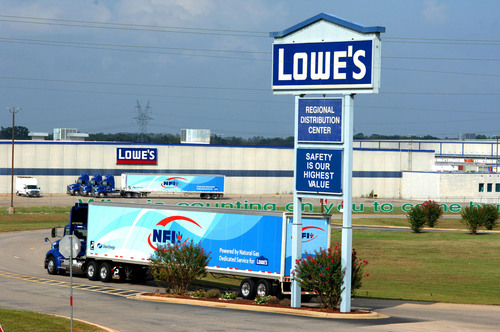 Lowe's dedicated fleet at Mount Vernon is among the first serving a major retail distribution center in North America to run solely on natural gas. With the transition from a diesel-fueled fleet to trucks powered by liquefied natural gas, Lowe's expects to reduce greenhouse gas emissions nearly 20 percent and control fuel costs as it transports up to 68 truckloads each day to stores in Texas, Louisiana and Oklahoma.   (PRNewsFoto/Lowe's Companies, Inc.)