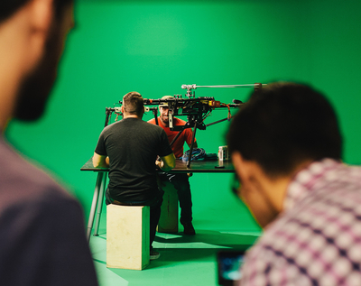 Chase Heavener, President & Pilot at Fiction, prepares a Red-Equipped RC Helicopter for a shoot. (PRNewsFoto/Fiction)