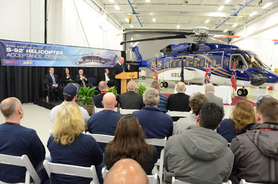 Bjorn Seljevold, Managing Director and Chairman of Norsk Helikopterservice, speaks at the S-92 delivery ceremony in Coatesville, Pa. Behind him on stage are (l. to r.) Sikorsky executives Brad Arnold, Dorith Hakim and Dan Hunter, and Milestone Technical Director Ken Tapping.  (PRNewsFoto/Sikorsky Aircraft Corp.)