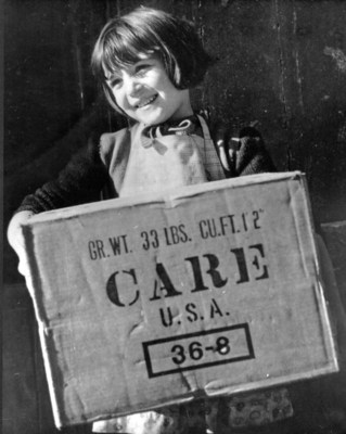 Regine Binet of Bayeux, France, a town not far from the Normandy invasion beaches, receives a CARE package in 1946 - a gift from an American she had never met. Credit:CARE