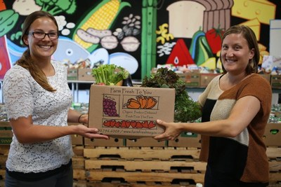 San Diego Food Bank employees received a donated box from Farm Fresh To You customers.