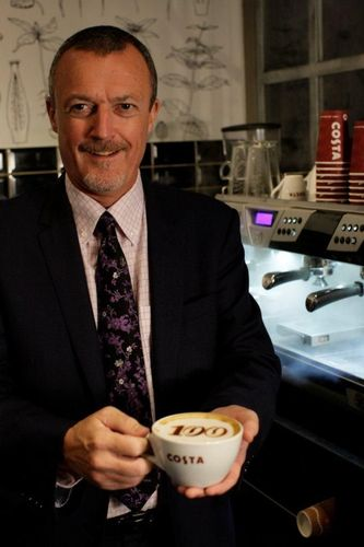 Eric Hughes, General Manager Costa UAE, make the first cup of coffee at the 100 UAE store (PRNewsFoto/Costa Coffee UAE)