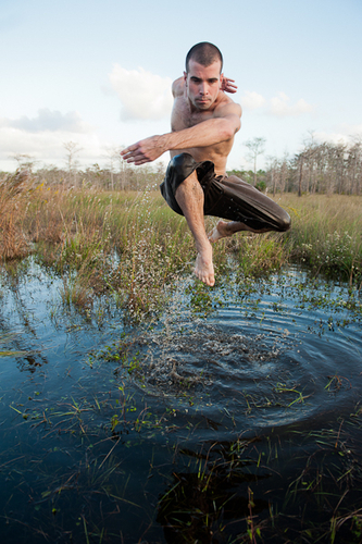 Steven Vaughn of Parsons Dance performs at Big Cypress National Preserve for the upcoming Face of America: Spirit of South Florida multimedia artistic adventure to be presented at Wolf Trap National Park on September 8, 2012.  (PRNewsFoto/Wolf Trap Foundation for the Performing Arts, Andrew Propp)