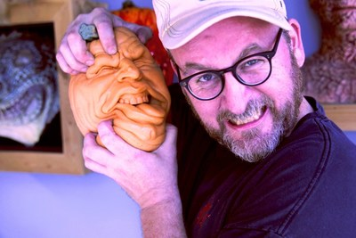 "Hollywood Special Effects Artist Todd Masters Poses With One Of His ""Oh Lantern Family"" Halloween Pumpkin Toys"