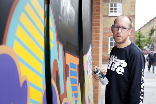 Street art star EINE puts the finishing touches to a large scale commission being installed this week on York Way in Kings Cross, in celebration of the completion of the Macmillan Campus. (PRNewsFoto/Macmillan Science and Education)