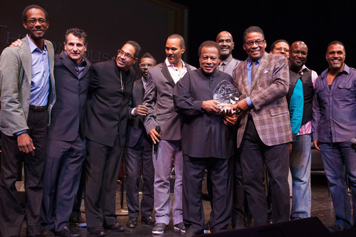 Wayne Shorter receives the Thelonious Monk Institute of Jazz Lifetime Achievement Award from Herbie Hancock surrounded by Wayne's band members Brian Blade, John Patitucci, Danilo Perez, trumpeter Roy Hargrove and members of the band Take 6.  (PRNewsFoto/Thelonious Monk Institute of Jazz)