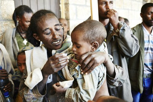 Children receive free antibiotics at a health station in Gamera/northern Ethiopia against trachoma infections. ...