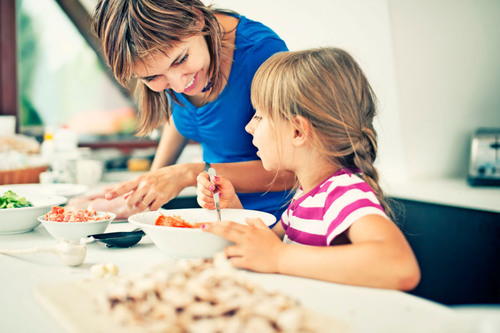 A new survey from LG Electronics reveals more than 40 percent of parents feel the most important reason they cook with their kids is to teach an important life skill.  (PRNewsFoto/LG Electronics USA, Inc.)