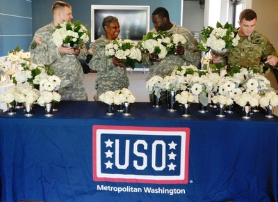Fresh artisan-designed flowers from premier floral and gifting company FTD help bring a smile to active duty soldiers and their loved ones Wednesday, Oct. 21 at the USO Warrior and Family Center at Bethesda.  FTD honors military service members 