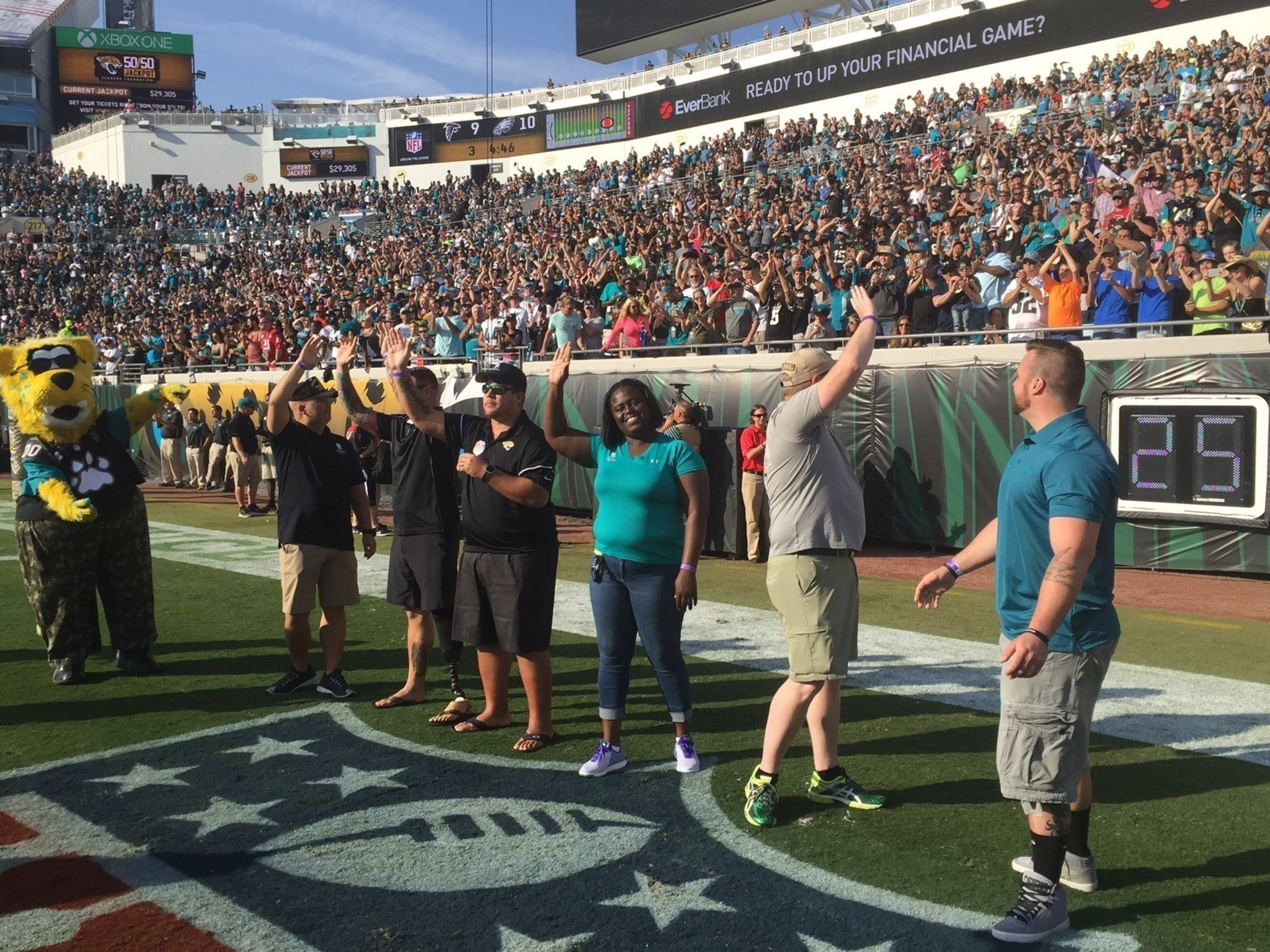Wounded veterans served by Wounded Warrior Project wave to the crowd during the NFL Salute to Service Game in Jacksonville, FL.