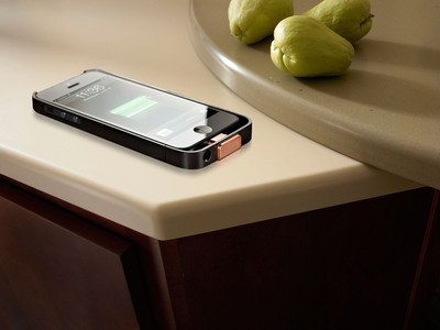 A rendering of the new PMA compatible Duracell Powermat wireless charger for the iPhone 5 being charged on a DuPont Corian kitchen countertop.  (PRNewsFoto/Power Matters Alliance)