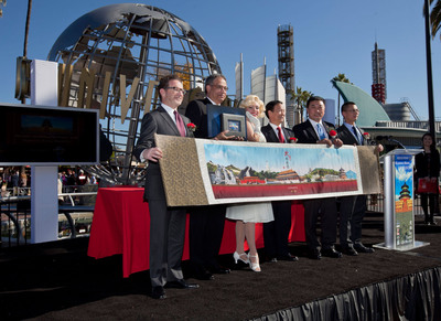 Universal Studios Hollywood President Larry Kurzweil, LA Tourism President & CEO Ernest Wooden Jr., People's Republic of China Consul General Qiu Shaofang, Beijing Municipal Commission of Tourism Development's Deputy Director Yu Debin and Vice Director Zhang Jing join the theme park's iconic Marilyn Monroe to commemorate the opening of the Beijing Tourism Cultural Fair which opened today and runs through January 6, 2013.   (PRNewsFoto/Universal Studios Hollywood)