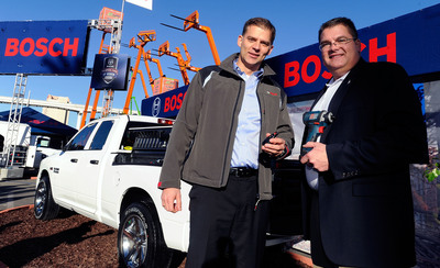 """Christian Heine, president, Bosch Power Tools North America (left) and Bob Hegbloom, director, Ram Truck Brand (right), name Ram the """"Official Truck of Bosch Power Tools & Accessories"""" today during the World of Concrete trade show. (PRNewsFoto/Bosch Power Tools) (PRNewsFoto/BOSCH POWER TOOLS)"""