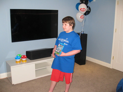 Twelve-year-old Elias of Peoria, Ill., enjoys his new gaming room, thanks to Kretschmar(R) Deli Meats, Kirby Foods and Make-A-Wish(R).  (PRNewsFoto/Kretschmar)