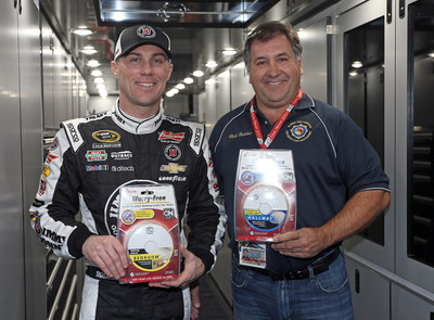 NASCAR Sprint Cup champion Kevin Harvick presents a donation of 250 smoke alarms to Rick Butcher, President, Florida Fire Marshals and Inspectors Association at the Daytona International Speedway on February 13.
