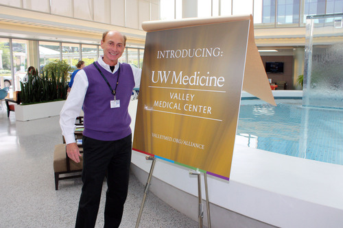 Renton, WA: Celebrating the newly formed strategic alliance between Valley Medical Center (VMC) and UW Medicine, Rich Roodman, VMC CEO, unveils a new co-branded logo.  (PRNewsFoto/Valley Medical Center)