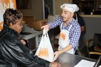 Chef Jordi Roca helps to hand out weekend meals for 100 seniors at Food Bank for New York City West Harlem Community Kitchen.