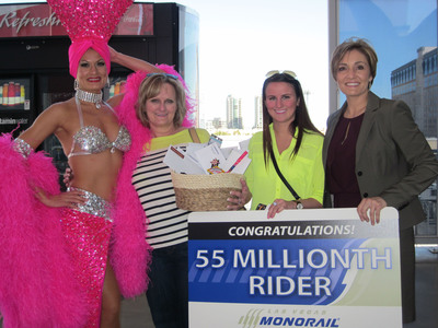 Photo detail: Pictured left to right Stacey Shea, Las Vegas Showgirl; Michelle Spatz; 55 Millionth Rider Kelsey Spatz; Ingrid Reisman, Las Vegas Monorail Company Vice President of Corporate Communications