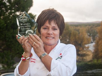 Laurie Figone, representing Bob's Red Mill Natural Foods, wins with her original Bob's Red Mill Steel Cut Oats dish at the 19th annual World Porridge Making Championship in Scotland.  (PRNewsFoto/Bob's Red Mill Natural Foods, Roy Brown)