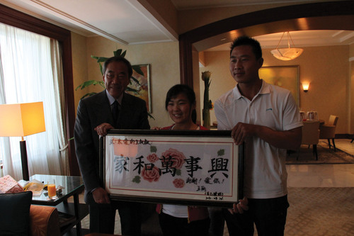"Wang Li couple gave a handmade cross-stitched ""Family Harmony"" to Mr. Charles B. Wang as a gift.  ..."