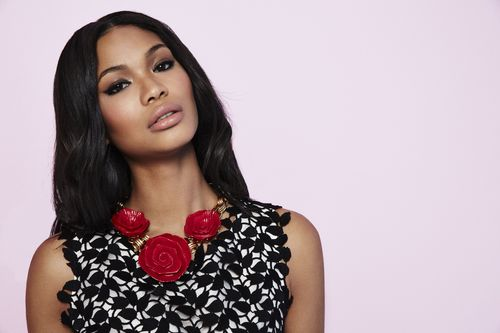 Model Chanel Iman wears Oscar de la Renta red rose acetate and metal necklace.