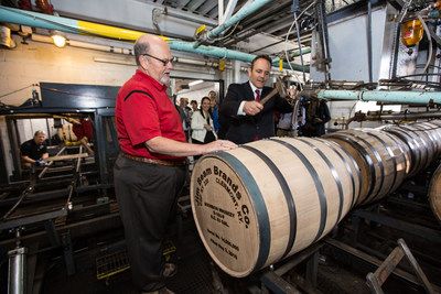 Kentucky Governor Matt Bevin hammers the bung into Jim Beam's 14 millionth barrel, May 2, 2016, at the Jim Beam American Stillhouse in Clermont, Ky. Bevin joined Fred Noe, Jim Beam's great-grandson and seventh generation master distiller for Jim Beam Bourbon, to make history today with the filling of the milestone barrel - a bourbon industry first.