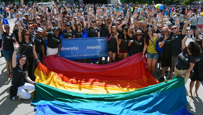 United employees marched through the streets of downtown Denver on Sunday as part of the city's annual LGBT Pride Festival - one of several parades the airline is participating in across the country to commemorate LGBT Pride Month. (PRNewsFoto/United Airlines)