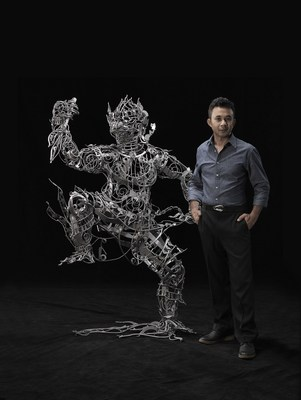 "Thai artist Banjerd Lekkong in his Bangkok studio with his iron sculpture ""Hanuman's Standing"" ahead of his solo exhibition at Agora Gallery in New York from May 20 to June 9, 2016."