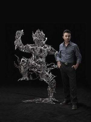 Thai artist Banjerd Lekkong in his Bangkok studio with his iron sculpture
