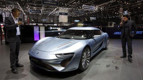 World premiere: The new QUANT e-Sportlimousine at the Geneva Motor Show 2014 with Nunzio La Vecchia (right) and Wolfgang Rother (PRNewsFoto/nanoFLOWCELL AG)