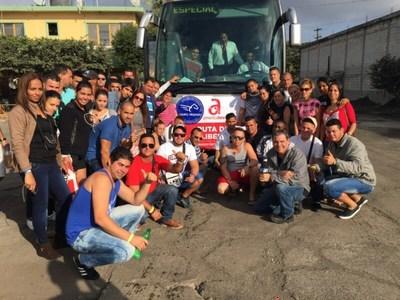 GROUP OF CUBANS RIDING RUTA DE LA LIBERTAD BUS