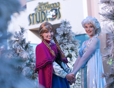 """Royal sisters Princess Anna and Queen Elsa, from Disney's hit animated motion picture """"Frozen,"""" will be featured all summer at Disney's Hollywood Studios theme park.  From July 5-Sept. 1, 2014, """"Frozen Summer Fun Live!"""" celebrates the worldwide phenomenon of """"Frozen"""" with a daily character procession, special sing-alongs with Anna and Elsa, themed fireworks, a polar playground, ice skating rink, ice carving demonstrations and a nightly party featuring a live band. Disney's Hollywood Studios is one of four theme parks at Walt Disney World Resort in Lake Buena Vista, Fla. (David Roark, photographer) (PRNewsFoto/Walt Disney World)"""