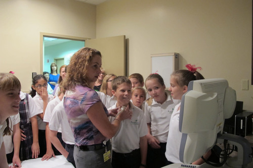 Dr. Claudia Bundschu, a radiologist who is medical director of the St. Anthony's Hospital Susan Sheppard McGillicuddy Breast Center, demonstrates how an ultrasound machine works on Parker Legard, 10, a student at Blessed Sacrament Catholic School in Seminole, Florida. Fifth-graders from the school visited the hospital after they raised money to donate to the center. (PRNewsFoto/BayCare Health System, St. Anthony's Hospital )