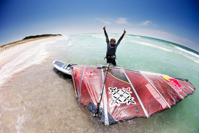 Kai Lenny celebrates his 56 mile journey across Lake Michigan.  (PRNewsFoto/Red Bull)